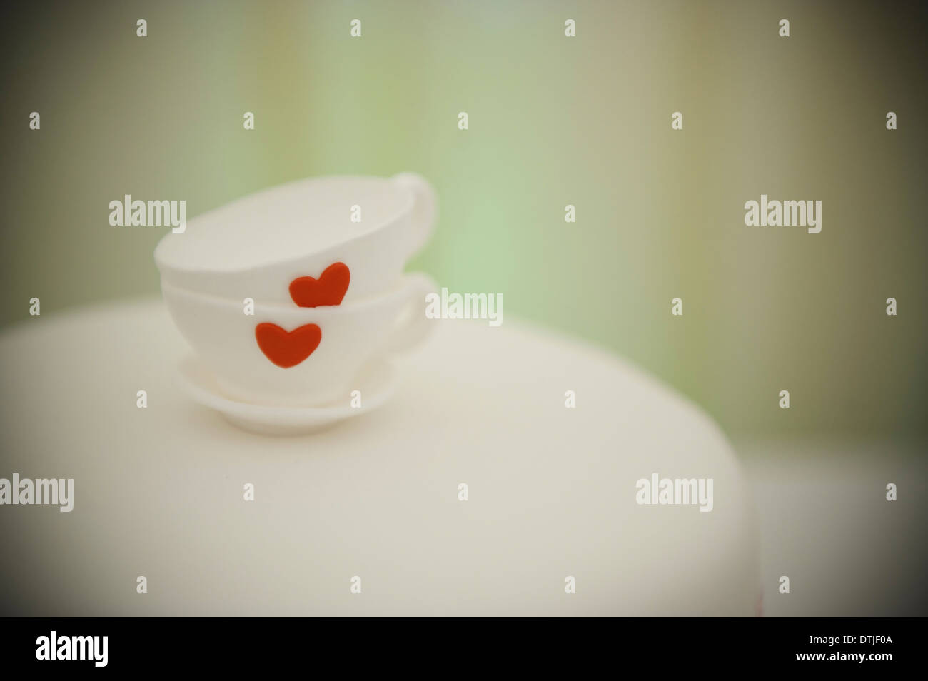 Two china cups stacked one on the other and decorated with a red heart England - Stock Image