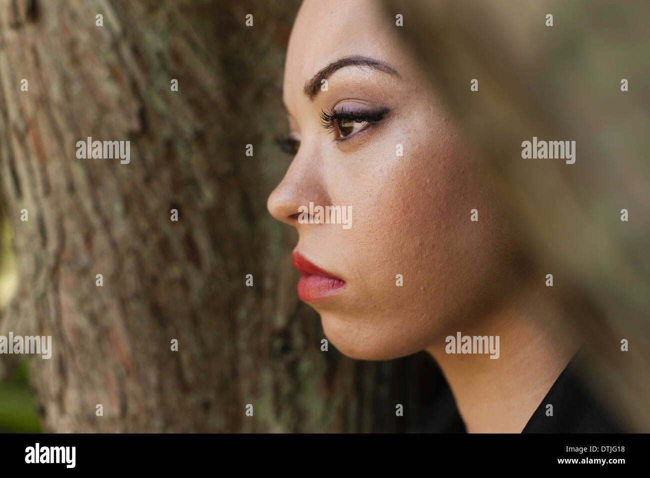 A young woman wearing makeup in a leather jacket  Pennsylvania USA - Stock Image