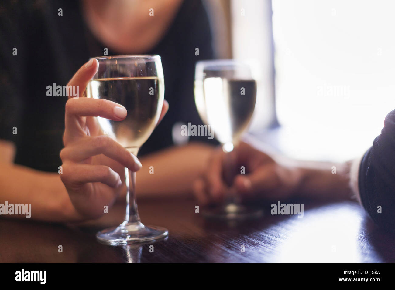 Two people a couple sitting in a bar having a glass of chilled white wine  Philadelphia Pennsylvania USA - Stock Image