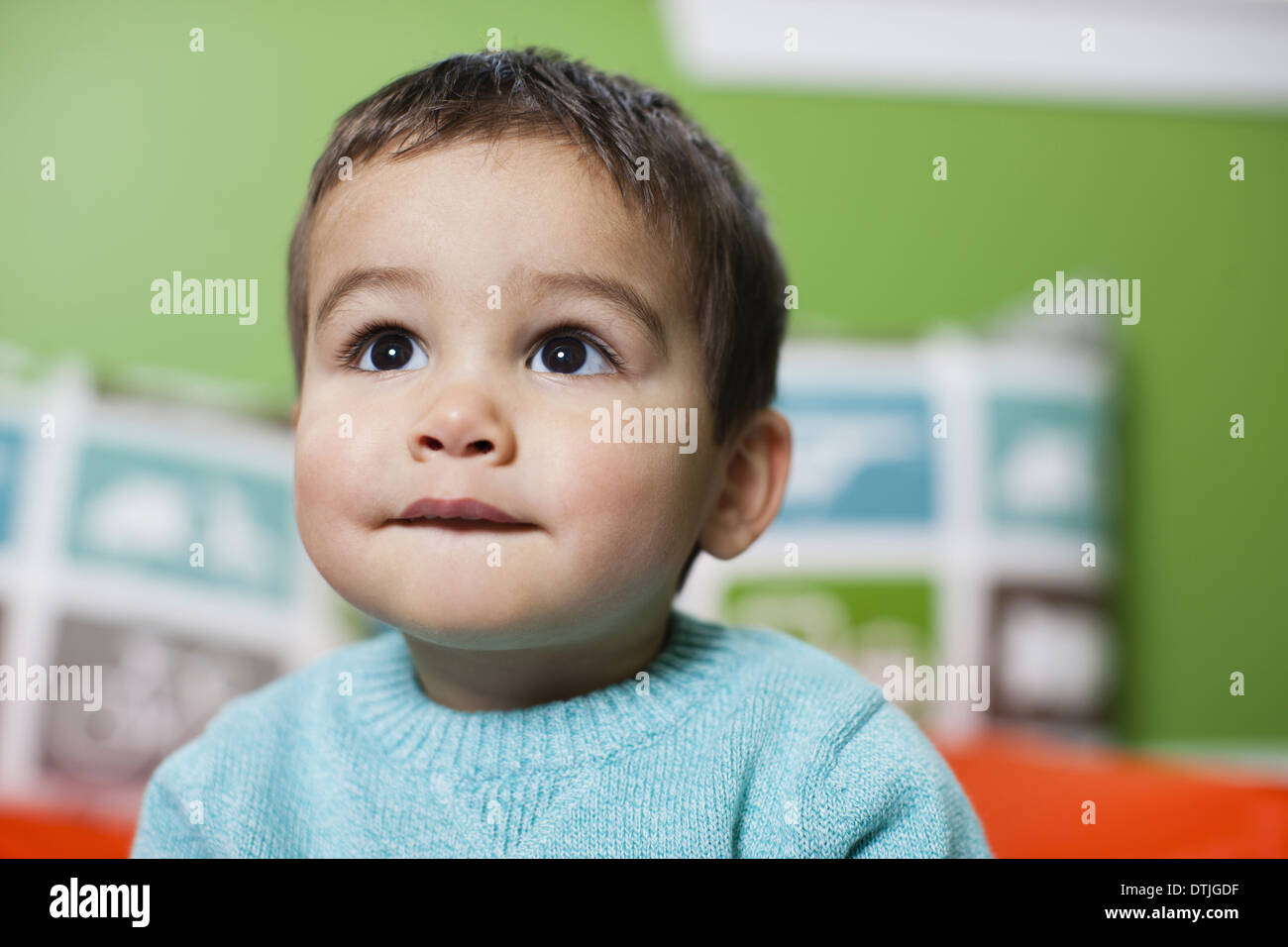 A young boy looking up with an anxious expression on his face  Pennsylvania USA - Stock Image