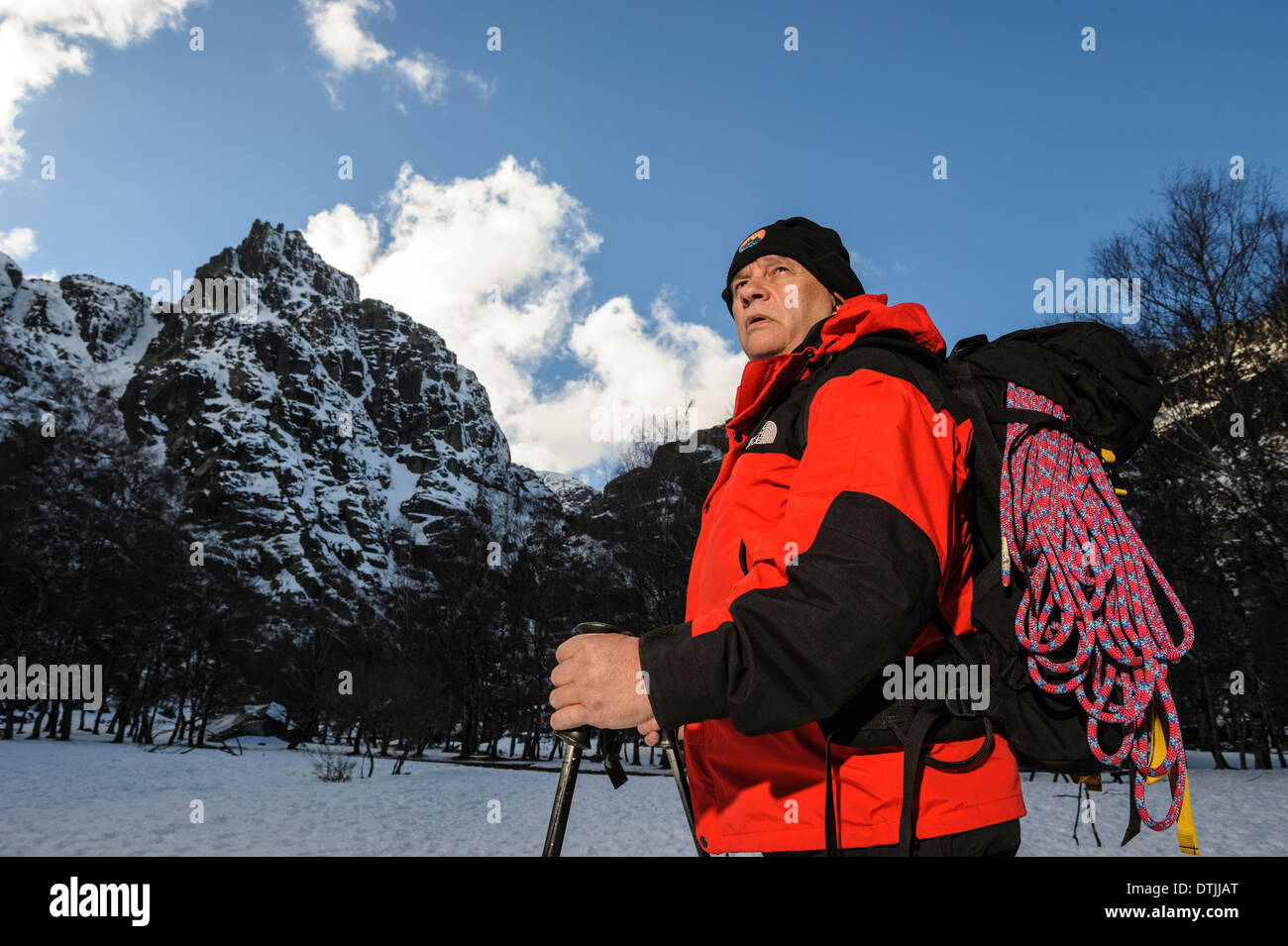 Middle aged man hiking in the Winter - Stock Image