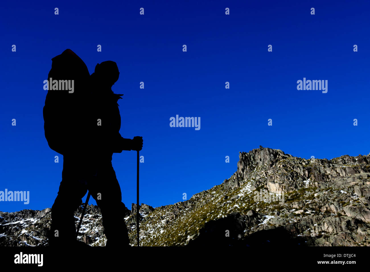 Silhouette of man hiking in the Winter - Stock Image