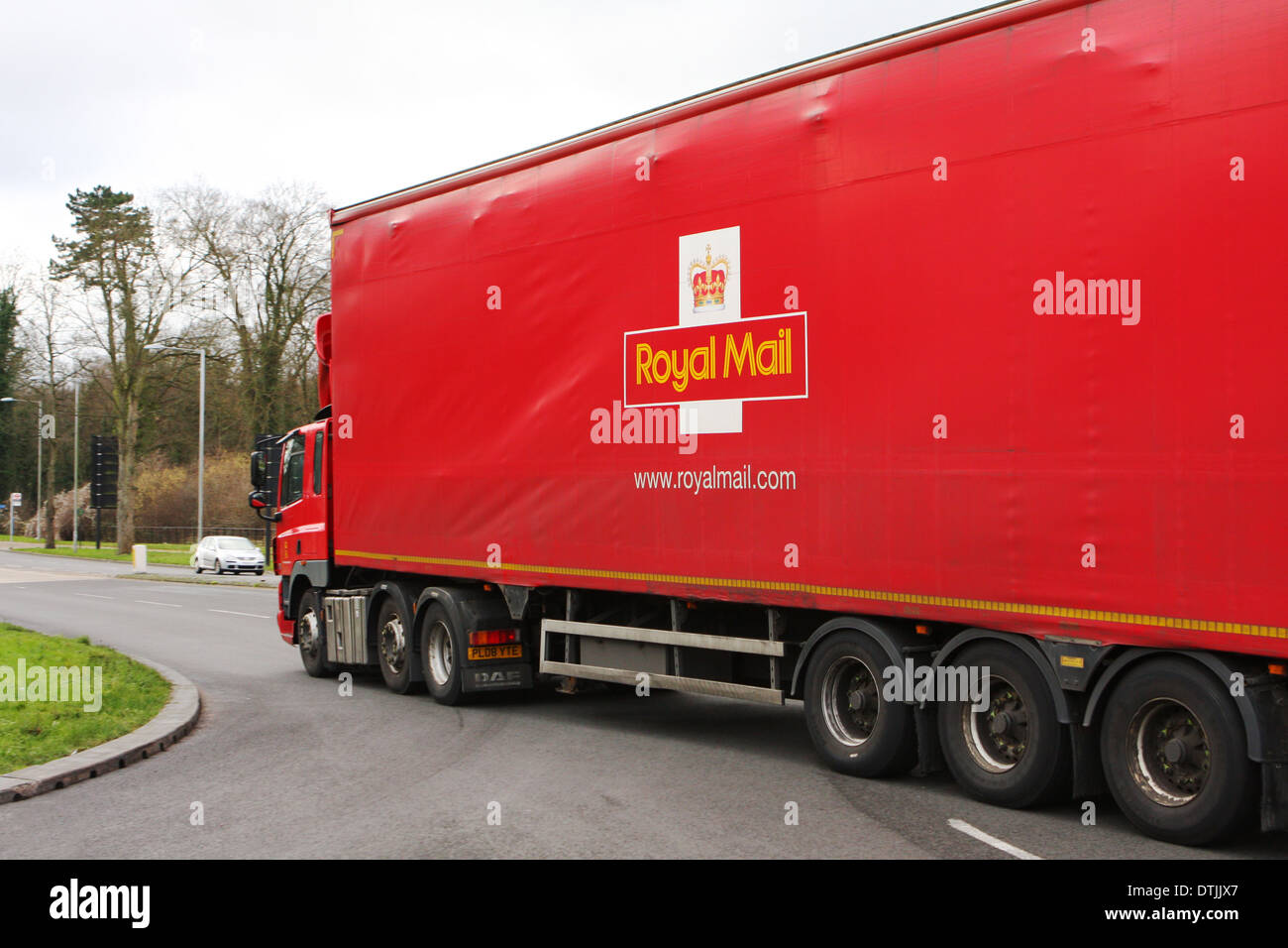 A truck traveling along a road in Coulsdon, Surrey, England - Stock Image