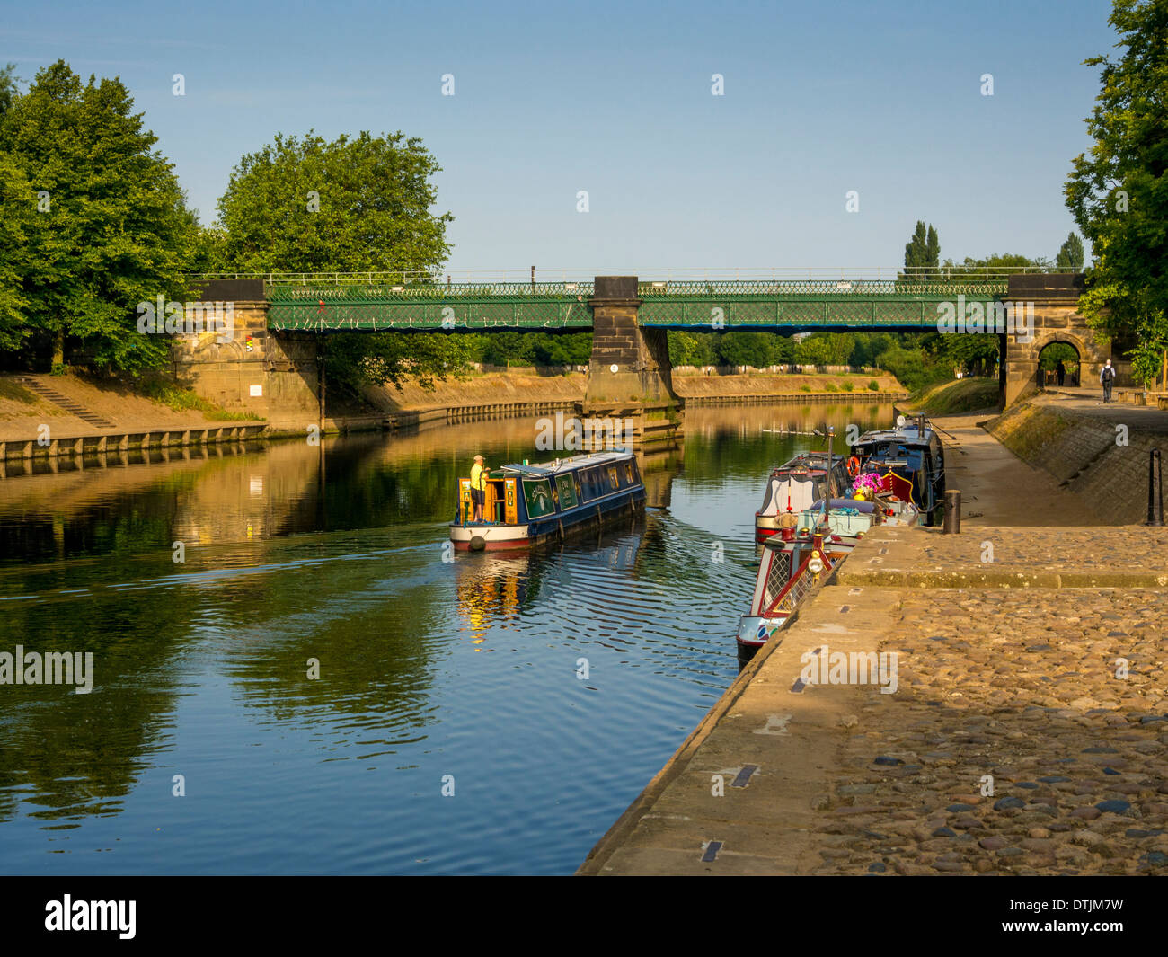 Longboat approaching Scarborough Railway Bridge on river Ouse in York - Stock Image