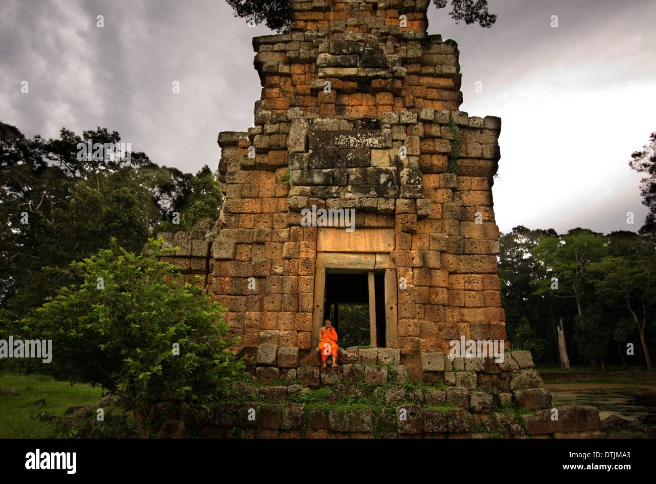 Buddhist Monk at the Temples of  Kleangs & Prasat Suor Prat. Angkor Thom. Rectangular sandstone building set opposite the Terrac - Stock Image