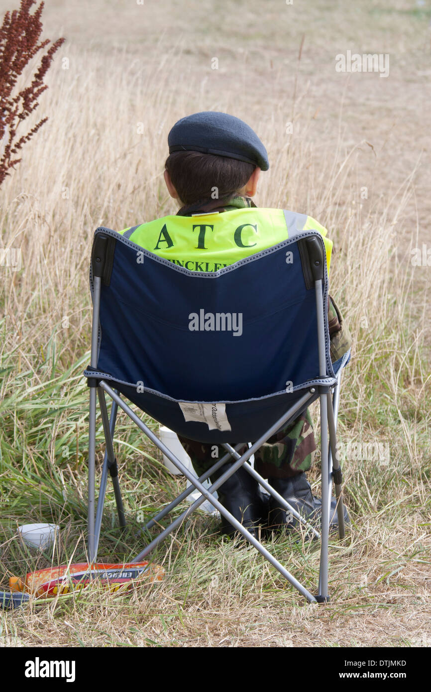 Young air cadet sitting in deck chair - Stock Image
