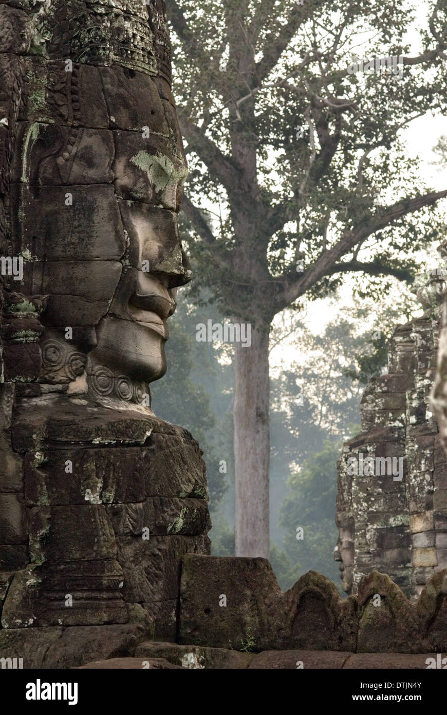 The faces of the Bayon temple. Angkor Thom. We stand before it stunned. It is like nothing else in the land. The Stock Photo
