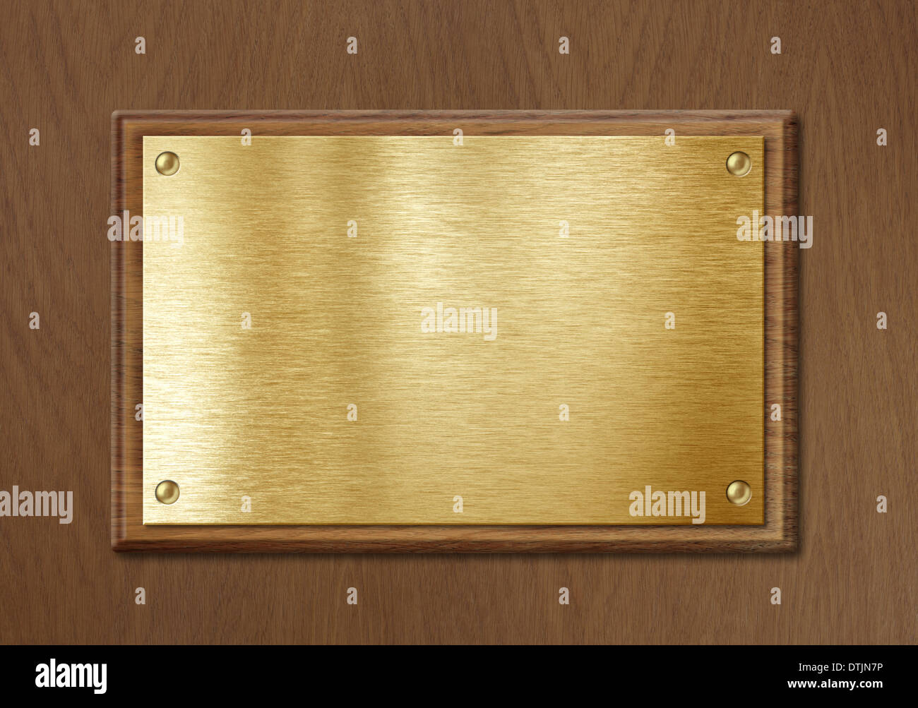 golden or brass plate for nameboard or diploma background in wooden frame - Stock Image
