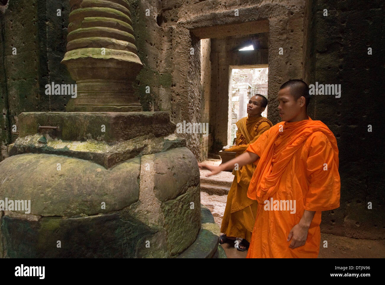 Two Buddhist monks in the inner part of the Temple Preah Khan. Bakan or Preah Khan Kampong Svay Temple. The Bakan temples are lo - Stock Image