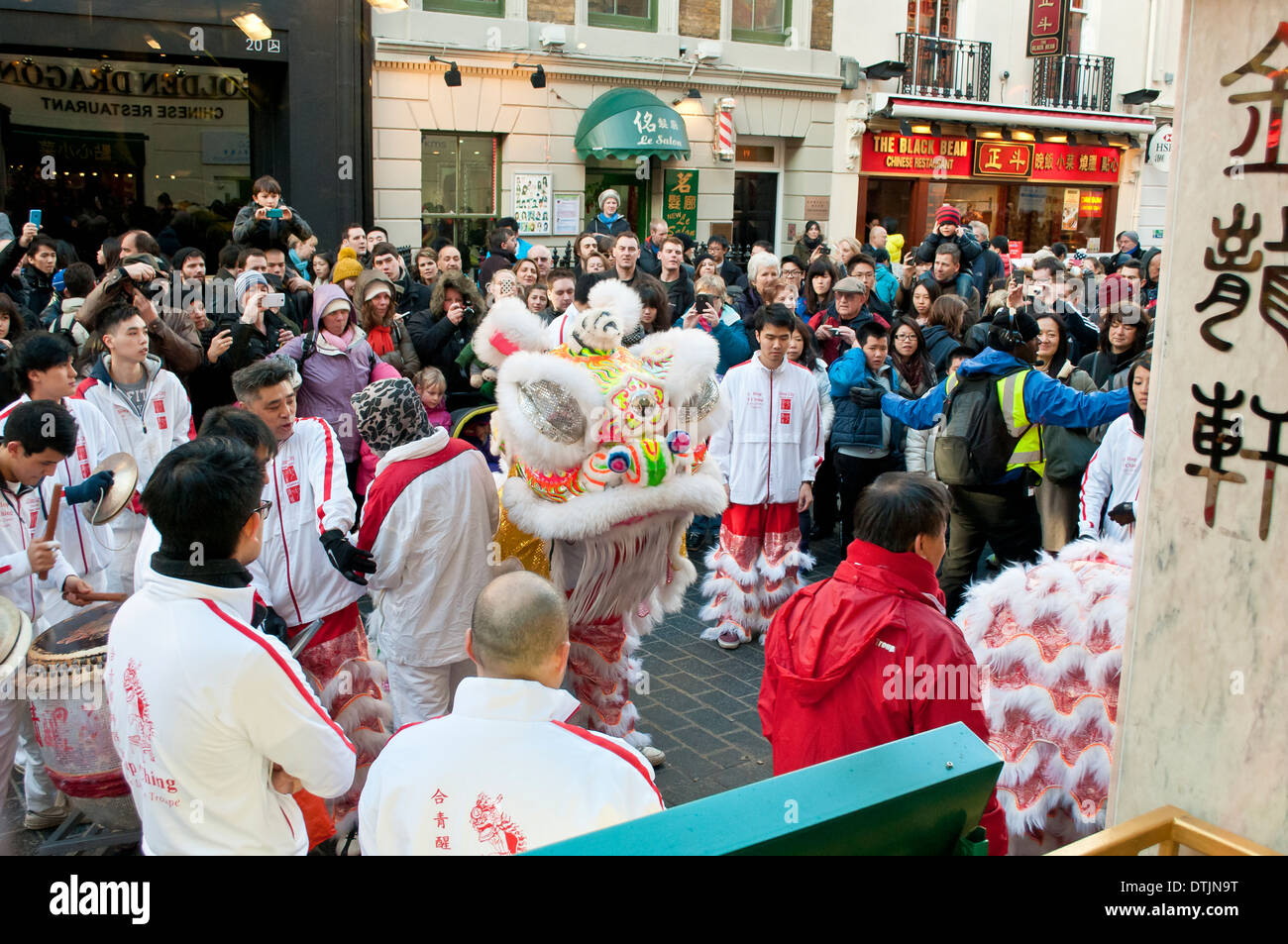 Lion dance, traditional Chinese custom believed to bring luck for the Chinese New Year, Chinatown, Soho, London, WC2, UK - Stock Image