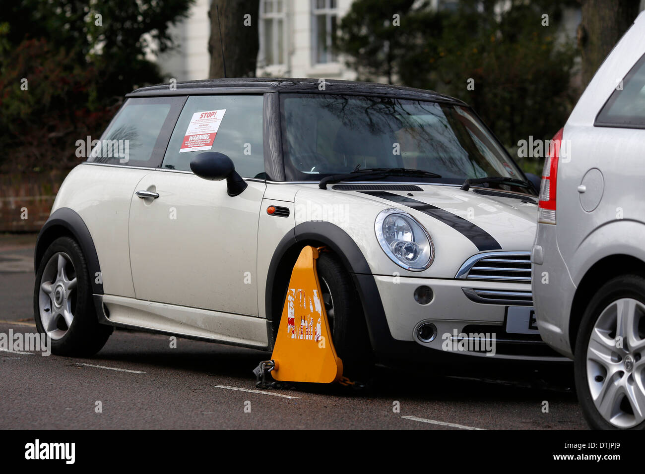 UK, London : A picture shows a clamped car on a road in London. - Stock Image
