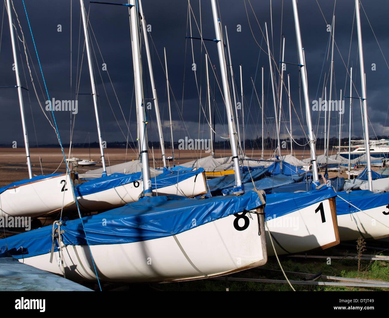Yachts with black skies behind, Exmouth, Devon, UK - Stock Image