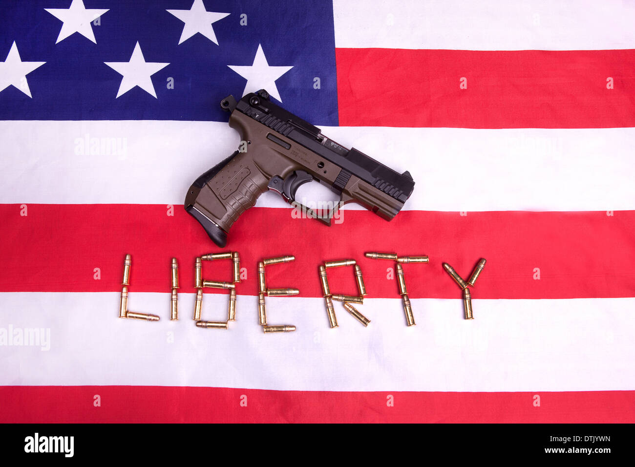A concept image of a pistol on a US flag and the ammo spelling out the word liberty. - Stock Image