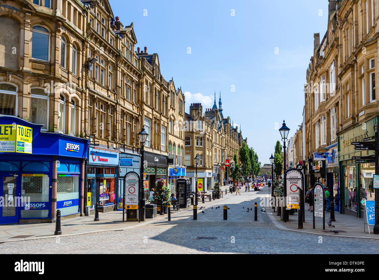 Shops on Cornmarket in the city centre, Halifax, West Yorkshire, England, UK - Stock Image