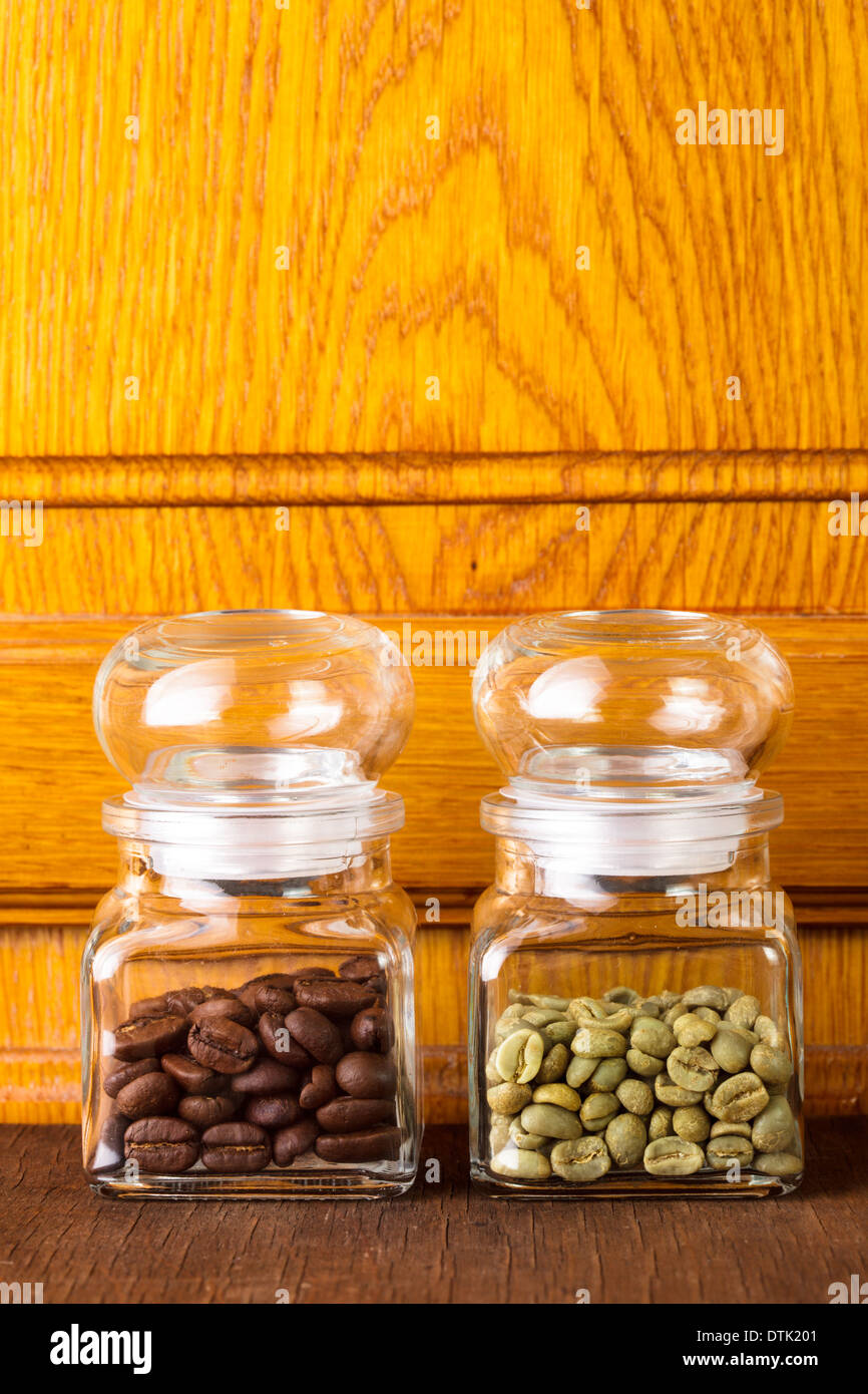 Black And Green Coffee Beans In The Glass Bottles Stock Photo Alamy