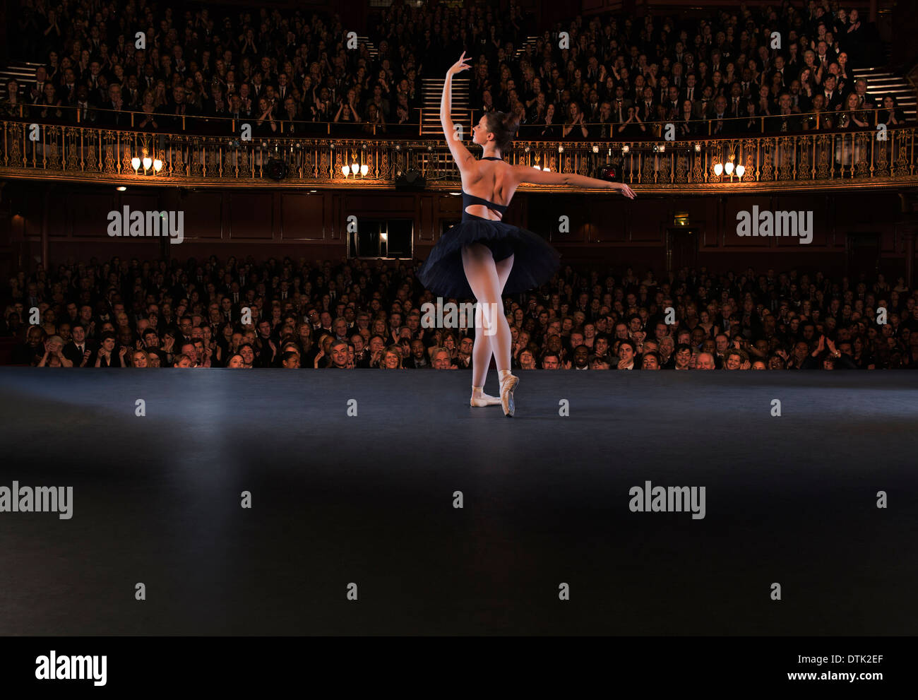 Ballet dancer performing on theater stage - Stock Image