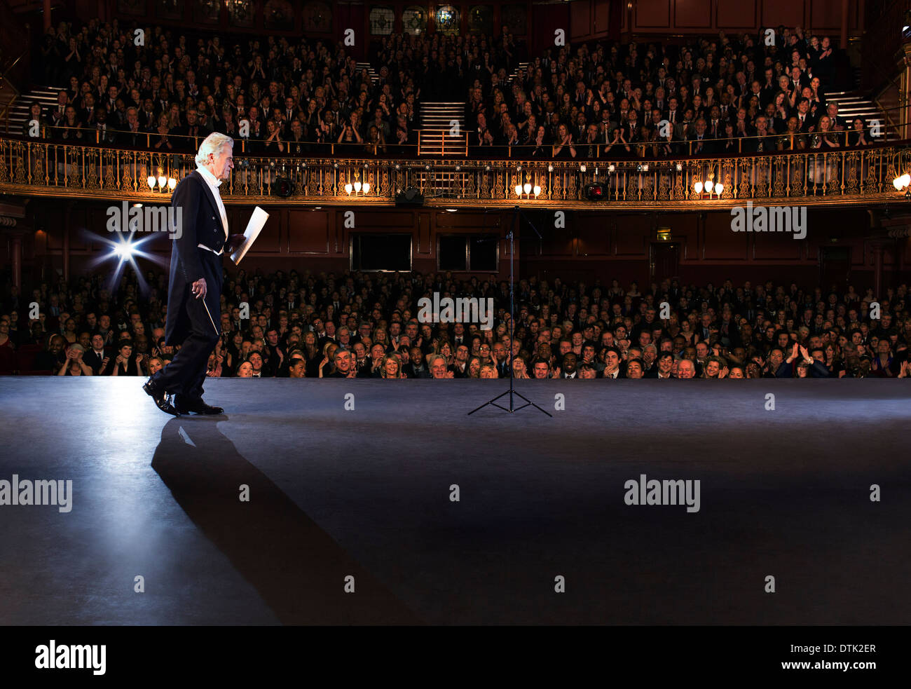 Conductor walking onto stage in theater - Stock Image