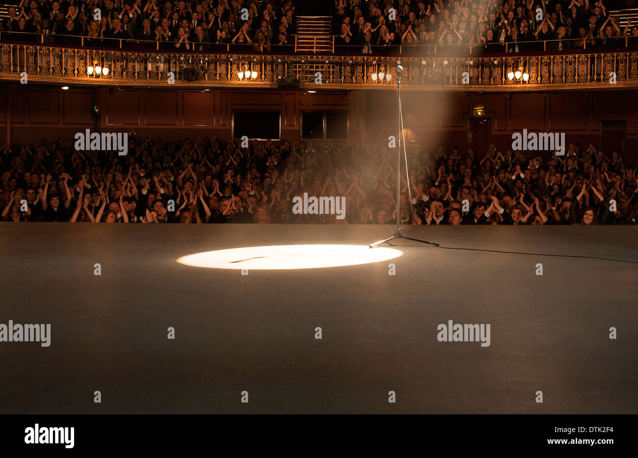 Spotlight shining on stage in theater - Stock Image
