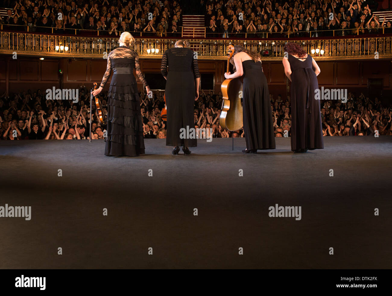 Quartet bowing on stage in theater - Stock Image