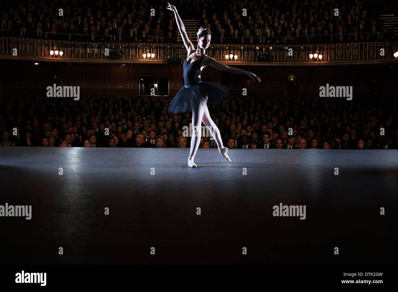 Ballet dancer performing on stage in theater Stock Photo