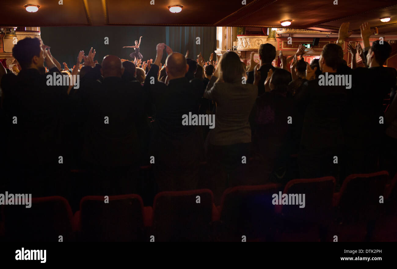 Audience watching ballerina on stage in theater - Stock Image