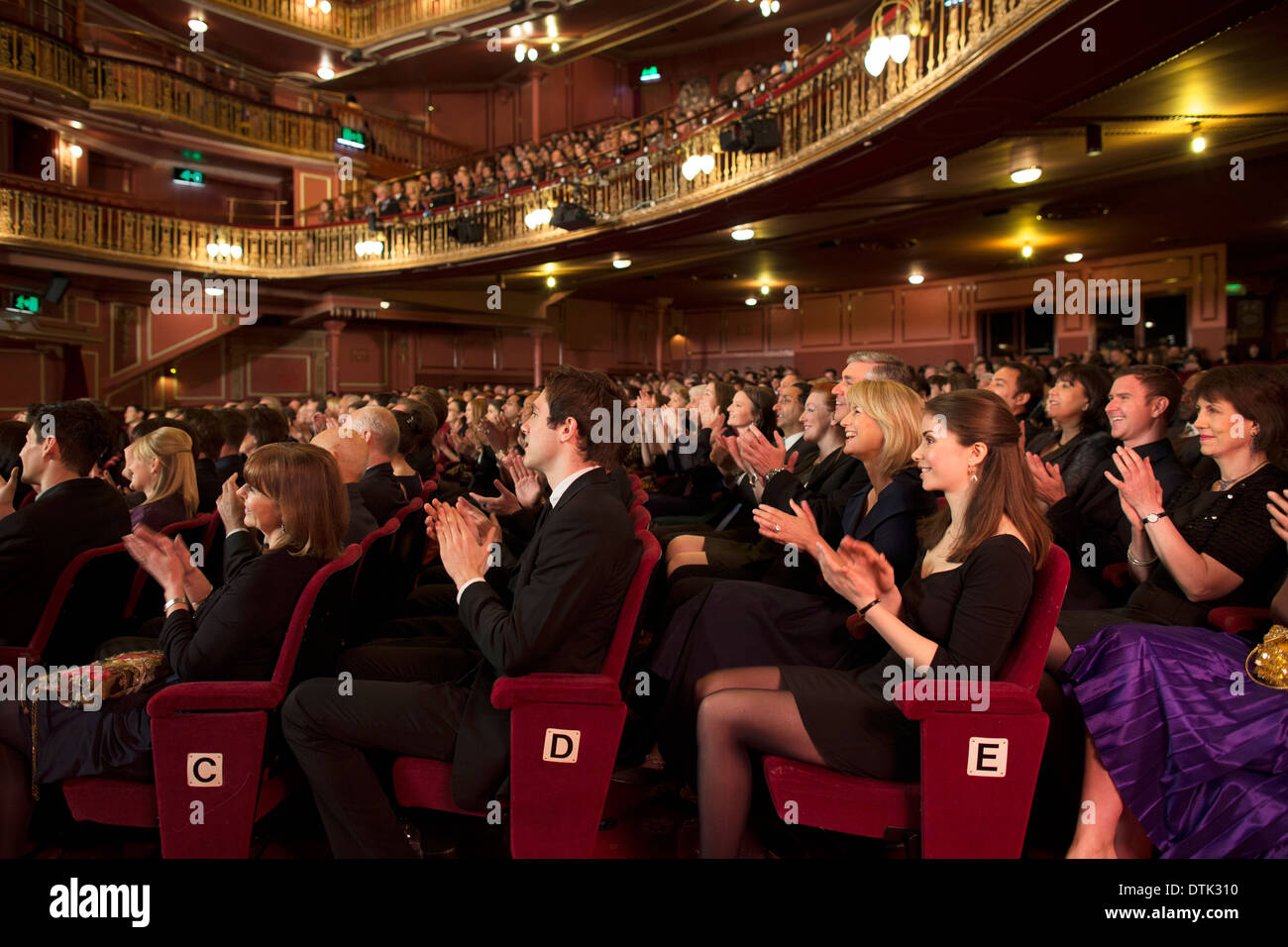 Audience applauding in theater - Stock Image