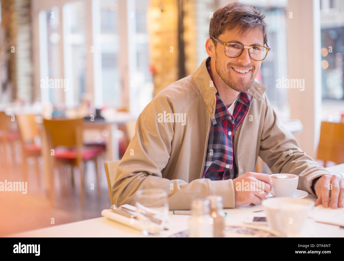 Man enjoying cup of coffee in cafe - Stock Image