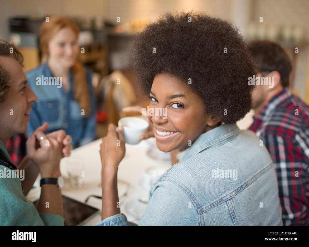 Friends enjoying coffee in cafe - Stock Image