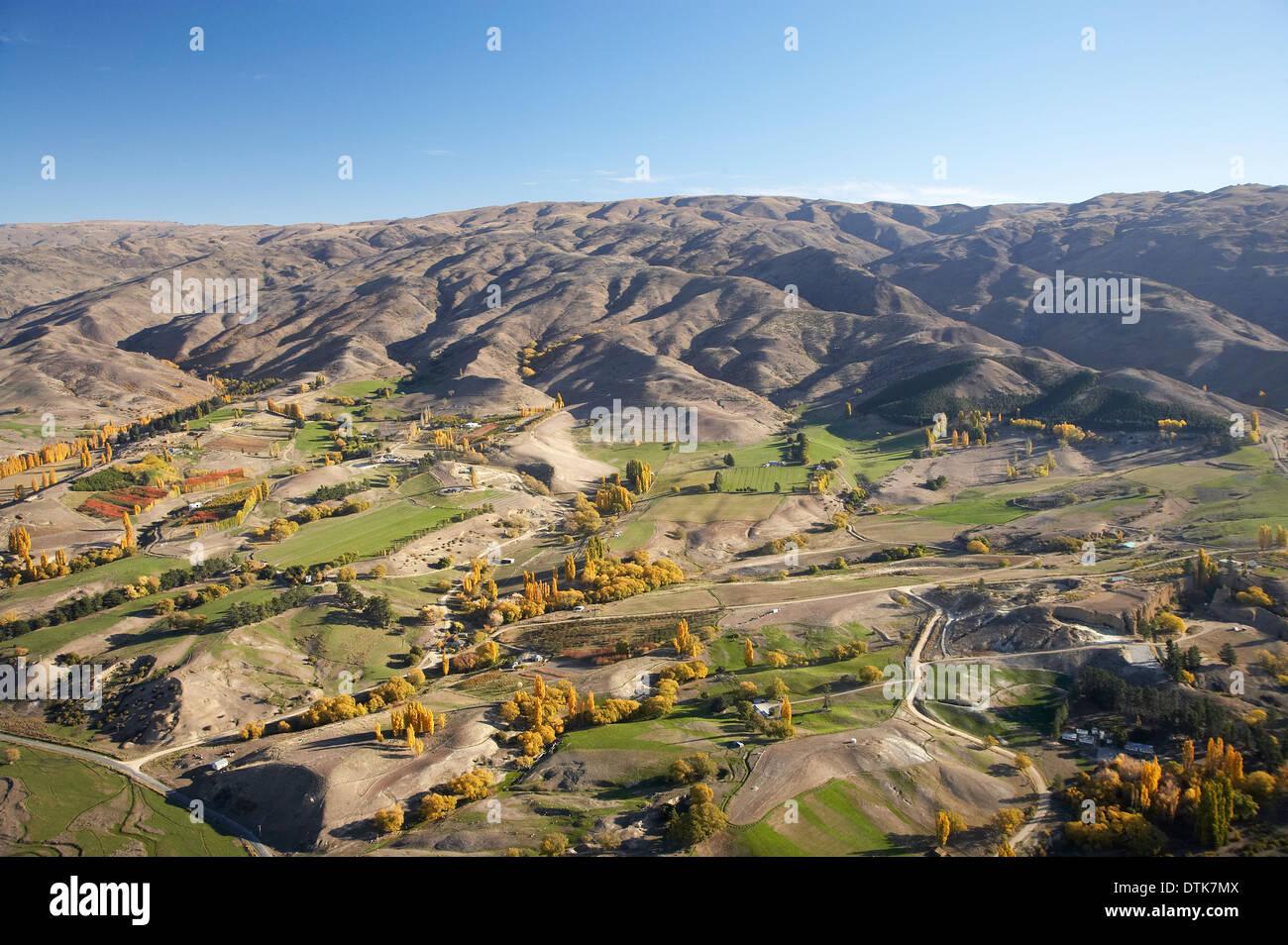 Farms and Carrick Range, Bannockburn, Central Otago, South Island, New Zealand - aerial - Stock Image