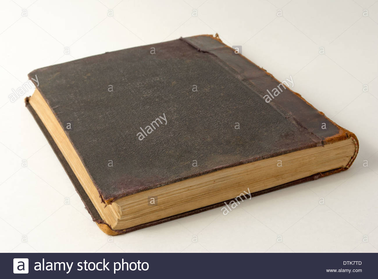 An old book close up on a light background. - Stock Image