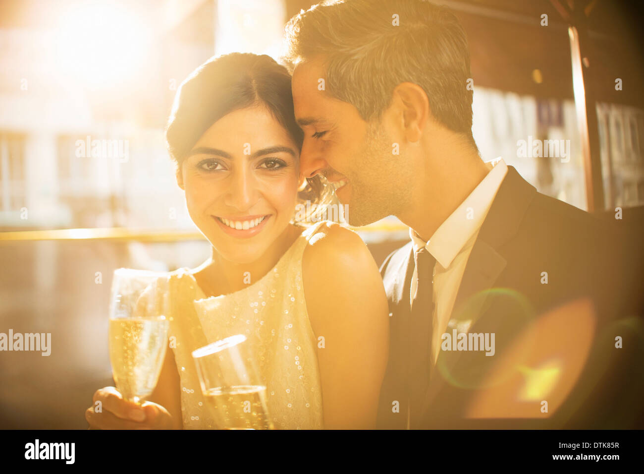Couple having champagne together - Stock Image