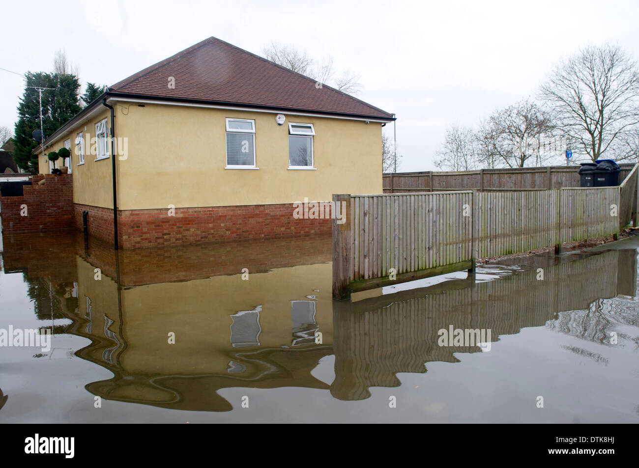 Flooded residential area and park in Staines. Driveway and streets flooded. - Stock Image