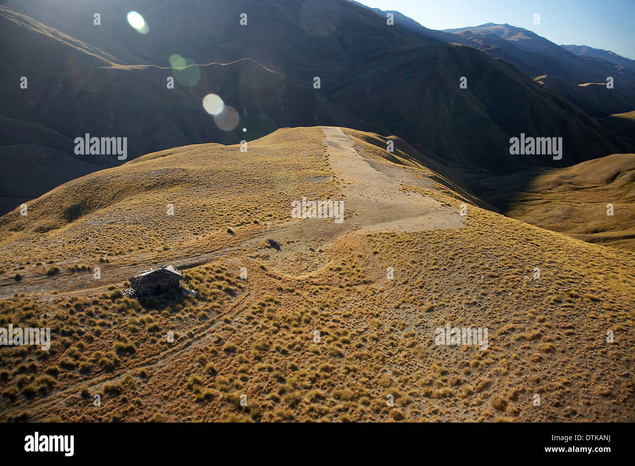 Old Hut Above Cardrona Valley, Otago, South Island, New Zealand - aerial Stock Photo