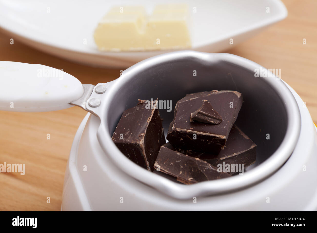 Chocolate Melting Pot Filled With Brown Chocolate Stock