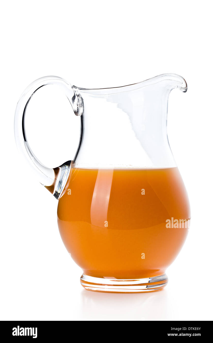 carrot juice in pitcher on white background - Stock Image