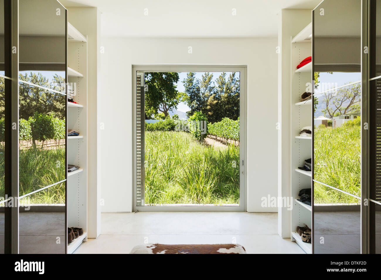 Mirrored closets framing window with view of vineyards Stock Photo ...