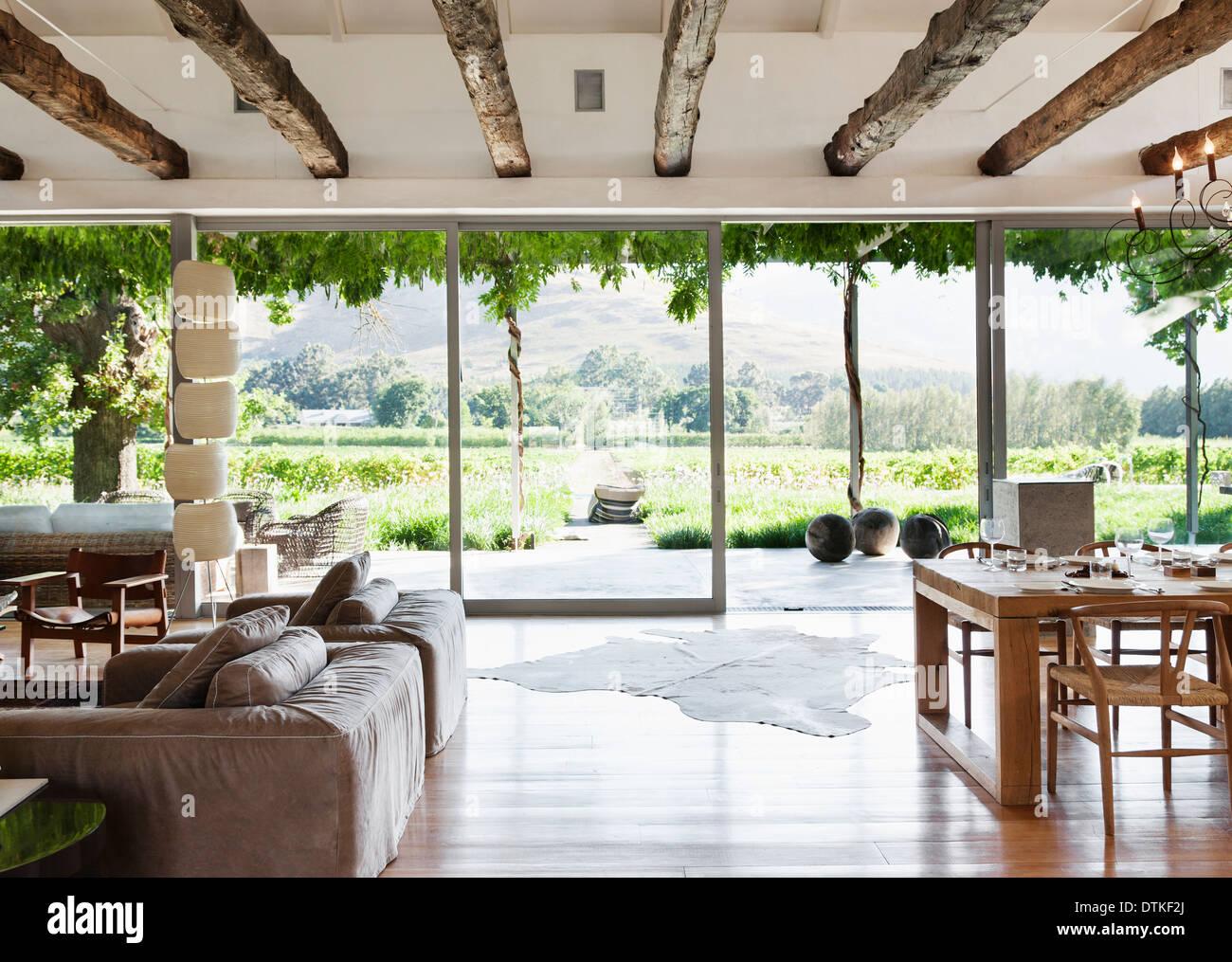 Open floor plan in luxury house overlooking vineyard - Stock Image