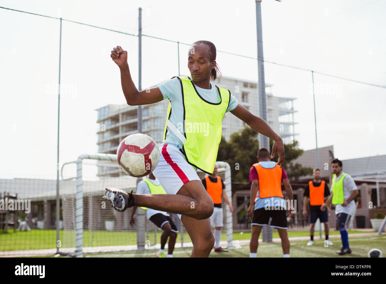 Soccer player training on field - Stock Image