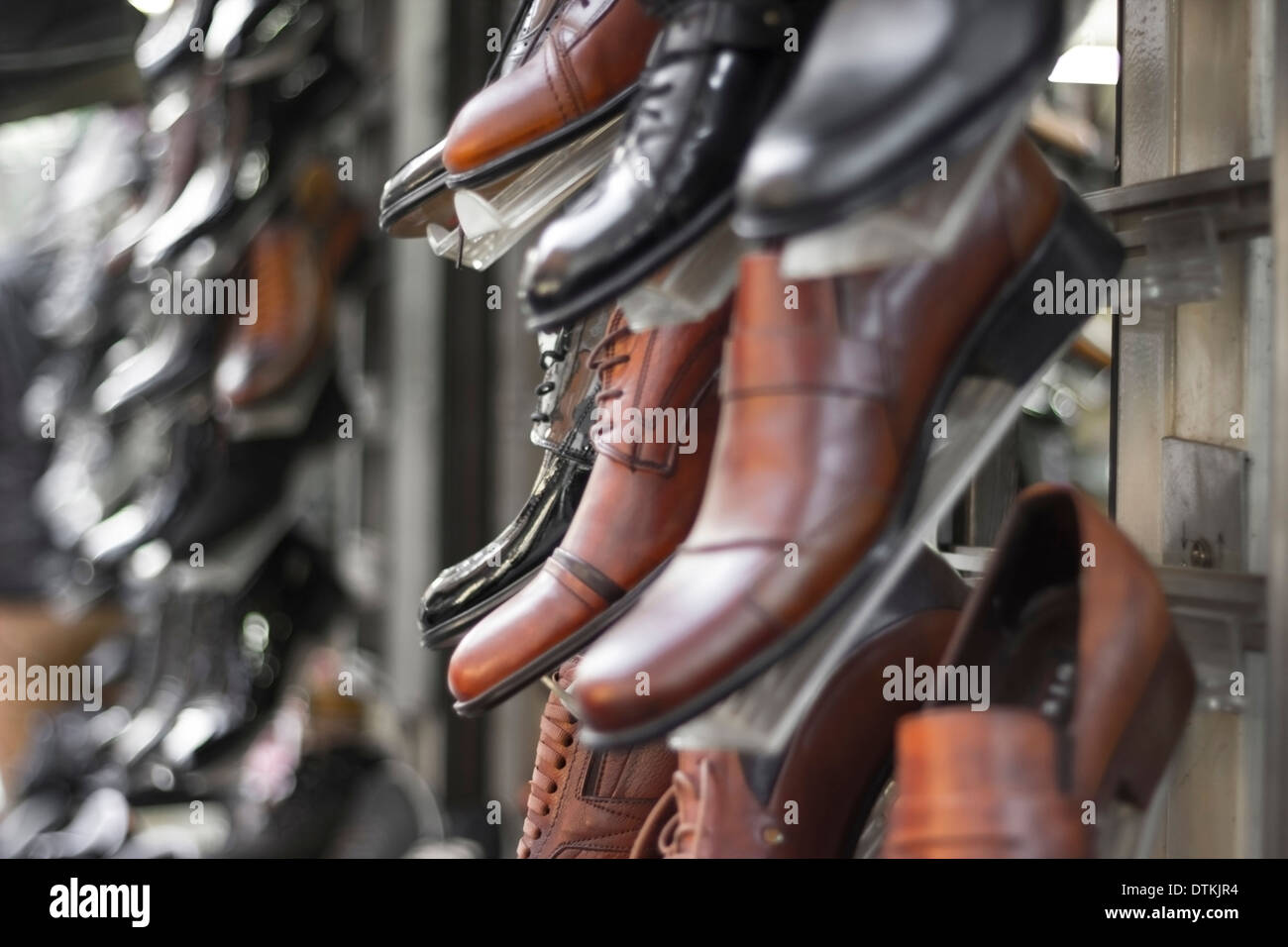 Closeup of a row of mens shoes in a mens clothing store. - Stock Image