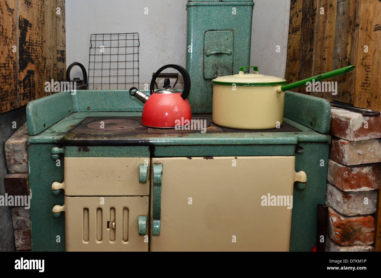 An old stove with cookeries in vintage kitchen. - Stock Image