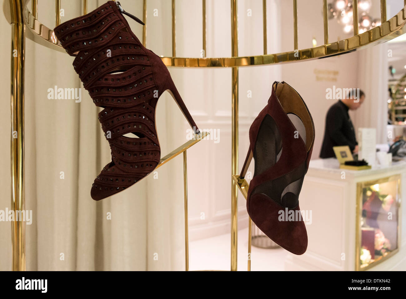 Shoes on display in shop in Level Shoe District in Dubai Mall United Arab Emirates - Stock Image