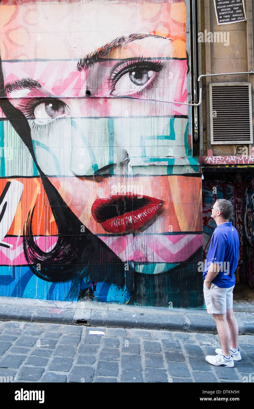 Street art painted on building wall in central Melbourne Australia - Stock Image