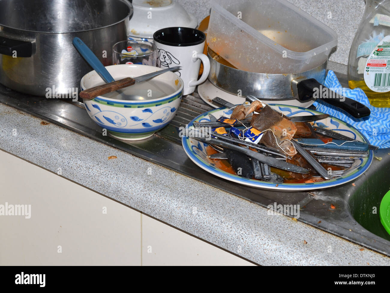Dirty Dishes in / on the sink - Stock Image