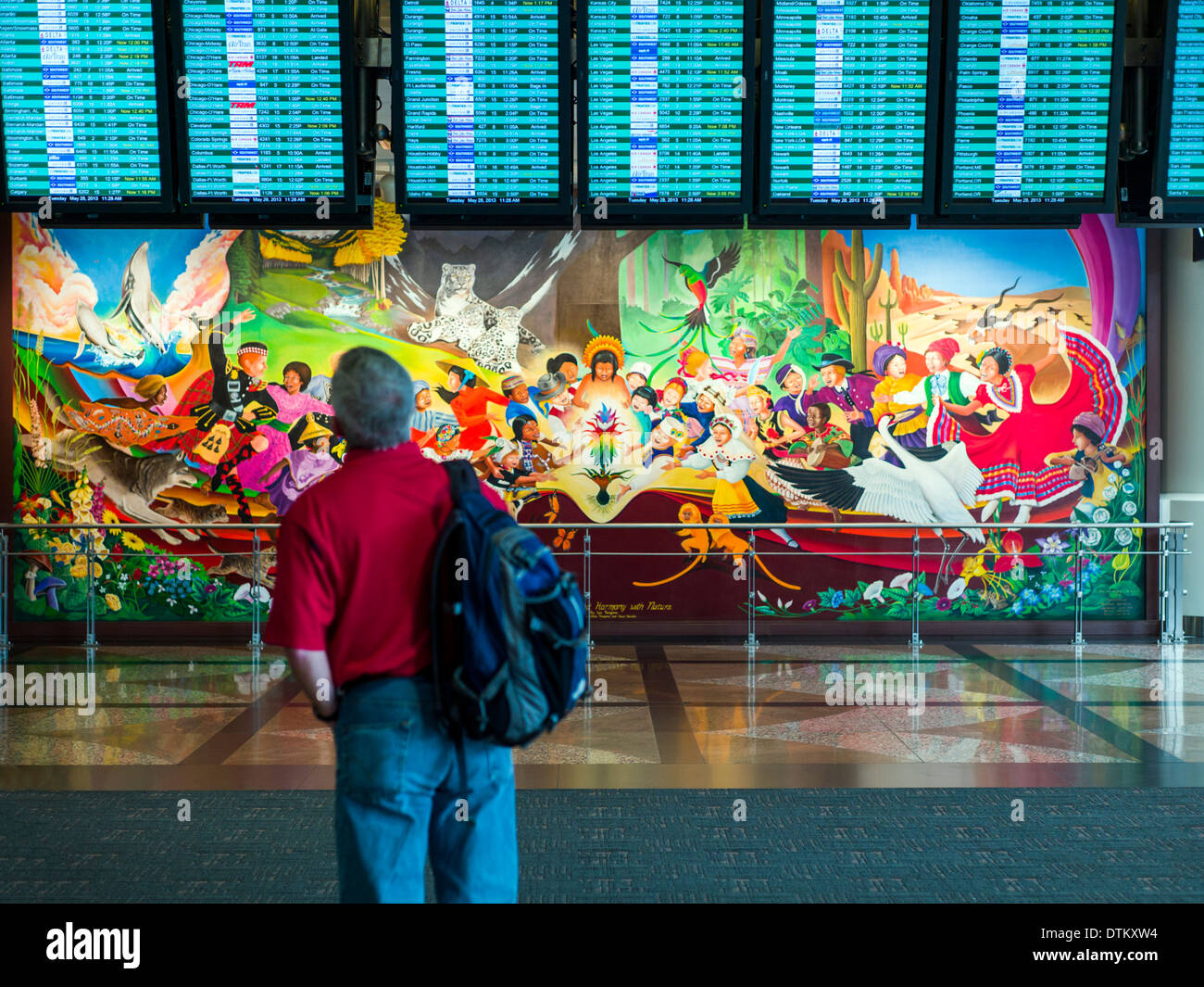 Colorful mural titled 'In Peace & Harmony with Nature', by Leo Tanguma, Denver International Airport, Colorado, USA. - Stock Image