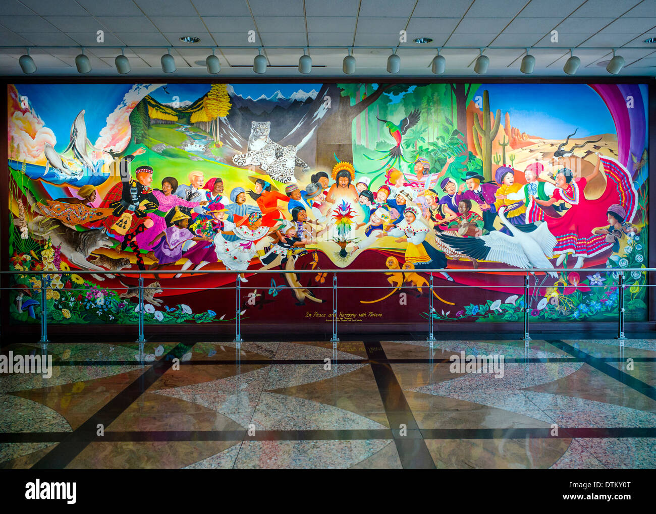 Colorful mural titled 'In Peace & Harmony with Nature', by Leo Tanguma, Denver International Airport, Colorado, USA - Stock Image