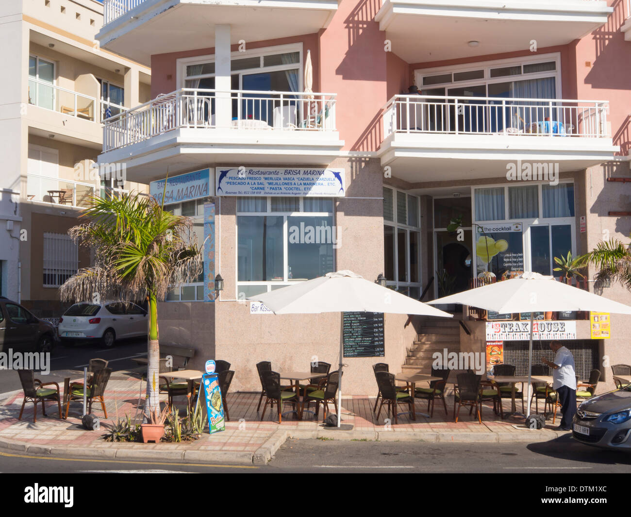 One of many inviting pavement bar restaurants in Tenerife Canary Islands Spain, here in Playa San Juan - Stock Image