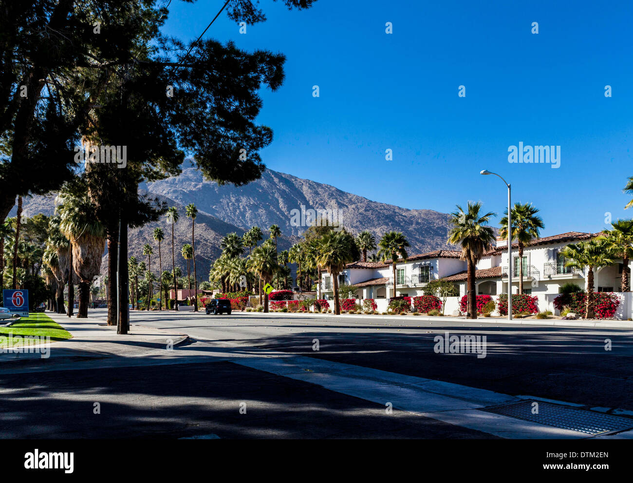 Condominiums bedecked with Bougainvillea in Palm Springs California February 2014 on Palm Canyon Drive Stock Photo