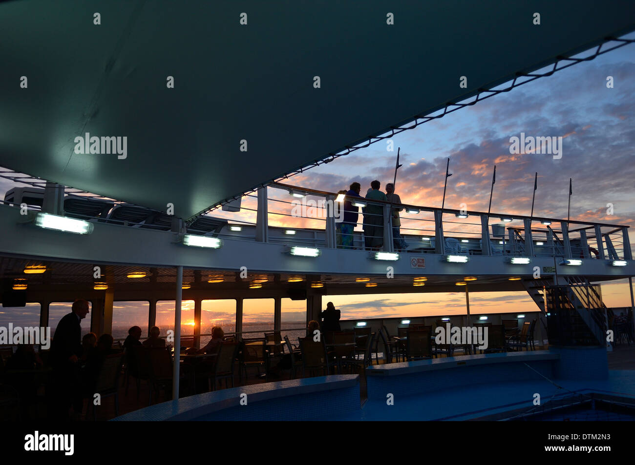 Passengers watching the the sunset on board the cruise ship Ocean Majesty. - Stock Image