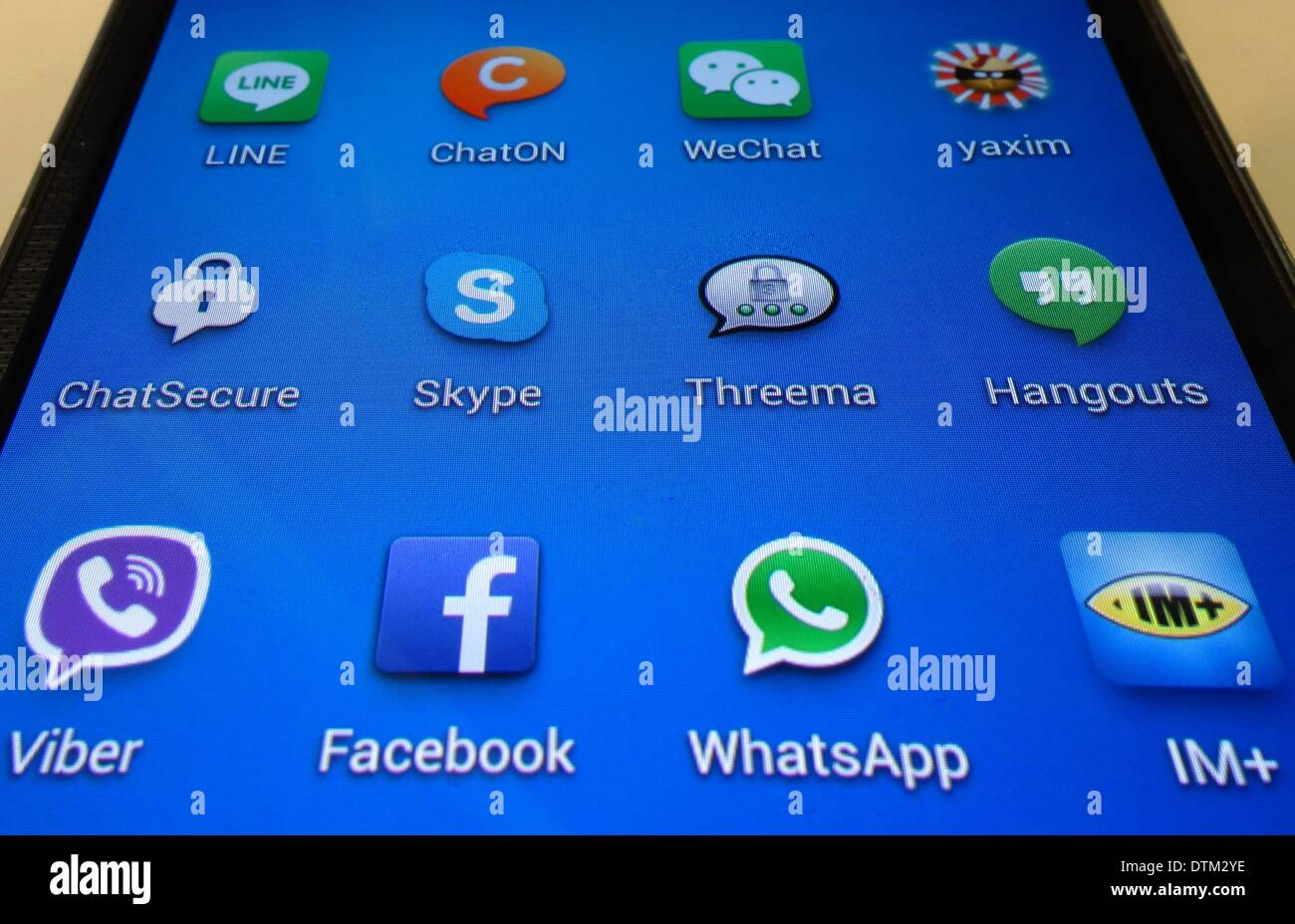 The apps (L, TOP-R, BOTTOM)Line, ChatOn, WeChat, Yaxim, ChatSecure, WhatsApp, Facebook, Hangouts, Threema, Skype, Viber and IM  are arranged on the display of a smartphone in Berlin, Germany, 20 February, 20 February 2014. Photo: Soeren Stache/dpa - Stock Image