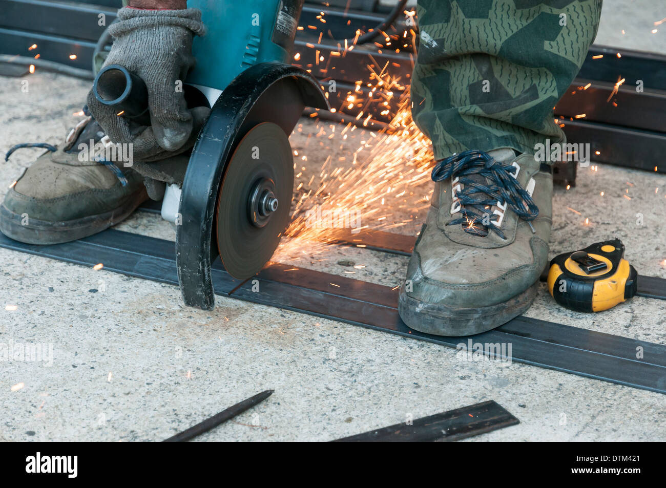 Worker with angle grinder - Stock Image